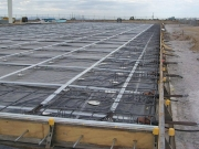 Joint free post-tensioned slabs on grade